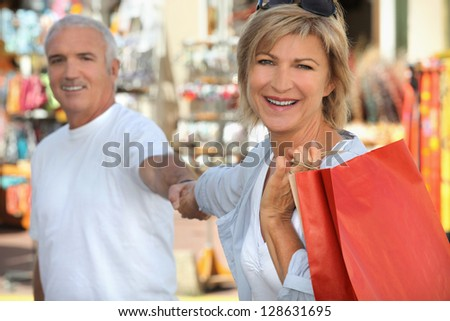 Mature couple shopping - stock photo