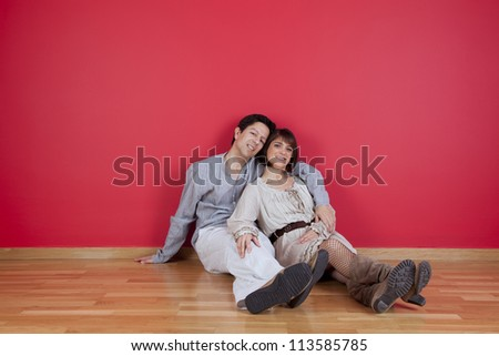 mature couple sited in the floor of his new house