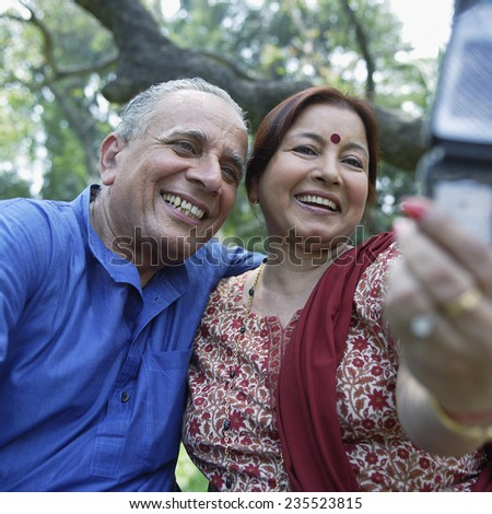 Mature Couple Taking Camera Phone Picture