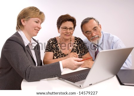 Mature couple talking to financial planner - stock photo
