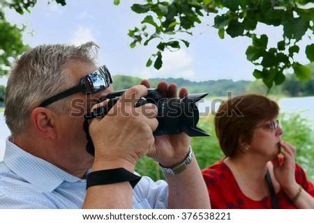 Mature couple travels to Europe, Trakai, Lithuania - stock photo
