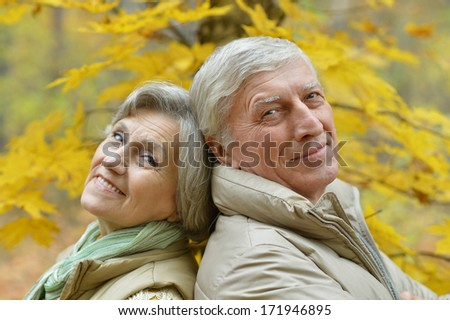 Mature couple walking in the park in the afternoon