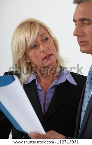 Mature couple with a report - stock photo