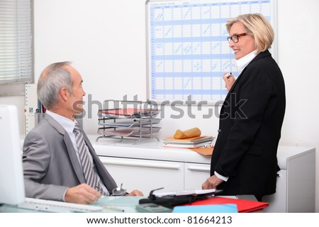 Mature couple working in an office