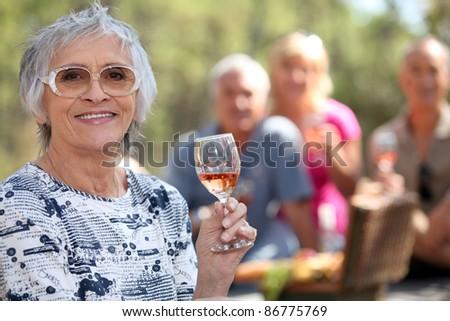 Mature couples enjoying a picnic. - stock photo