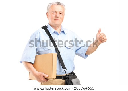 Mature courier holding a package and giving thumb up isolated on white background - stock photo