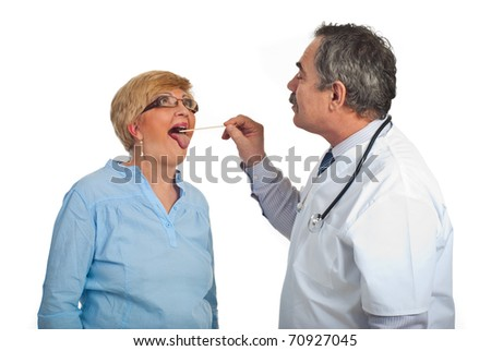Mature doctor examine with depressor sore throat to woman patient isolated on white background