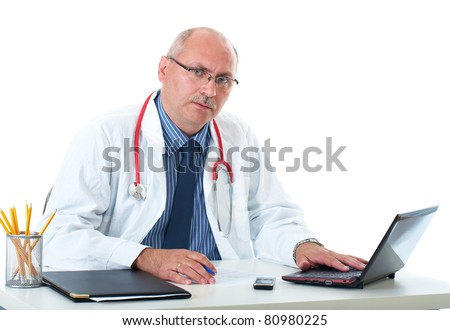 mature doctor fill some medical records, isolated on white