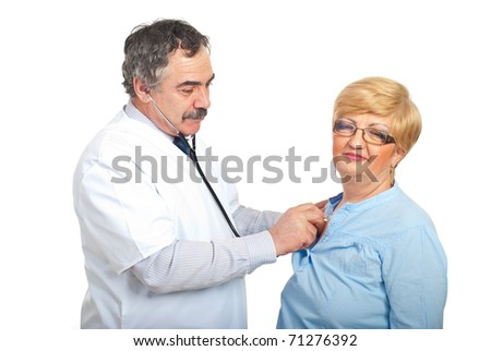 Mature doctor man examine  with stethoscope patient woman isolated on white background - stock photo