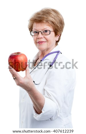 Mature doctor nutritionist holding red apple in one hand, isolated on white background - stock photo