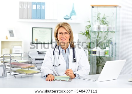 Mature doctor woman in a clinical office. Health care concept. - stock photo
