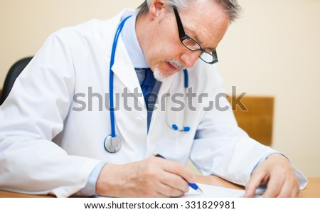Mature doctor working in his studio