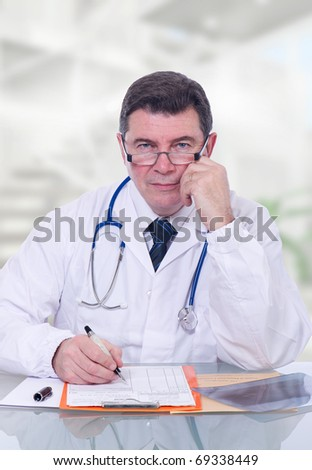 mature doctor writing