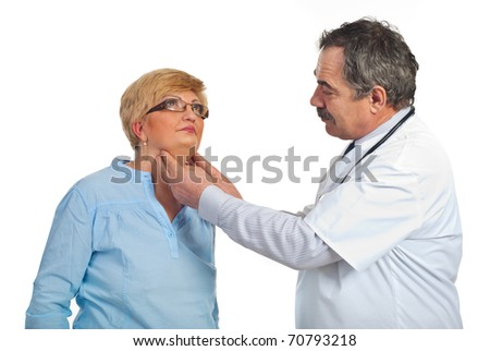 Mature endocrinologist checking goiter to a middle aged patient woman with glasses isolated on white background - stock photo