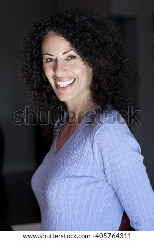Mature Ethnic Woman Smiling At The Camera - stock photo