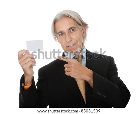 Mature executive showing a empty business card - stock photo