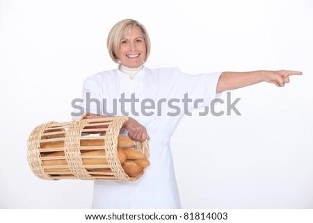 Mature female baker - stock photo