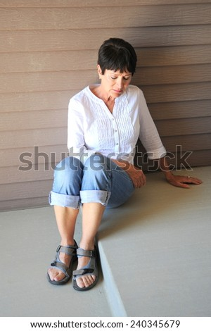 Mature female beauty expressions outside. - stock photo