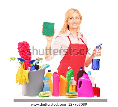 Mature female cleaner posing with cleaning equipment isolated on white background - stock photo