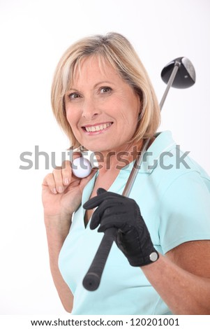 Mature female golfer - stock photo