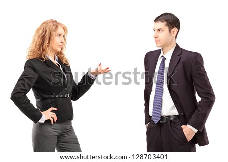 Mature female in a formal wear having a conversation with a young male colleague isolated against white background - stock photo