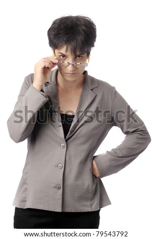 mature female teacher looking over her glasses. isolated on white background - stock photo