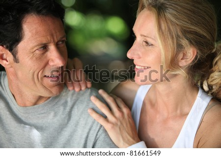 Mature fit couple exercising together in the countryside - stock photo