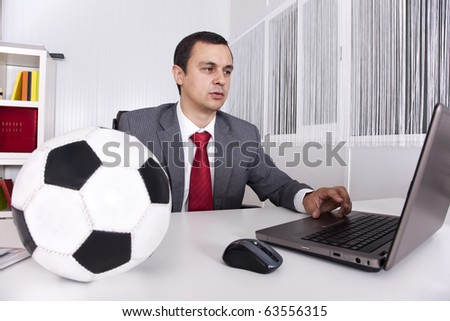 Mature football businessman manager working at the office - stock photo