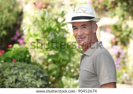 mature gentleman in garden - stock photo