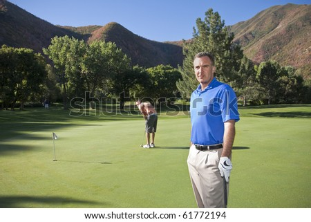Mature Golfer on the course ready to play - stock photo