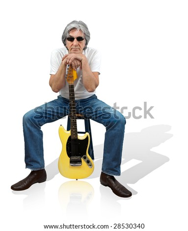 Mature gray-hair musician with his yellow electric guitar - stock photo