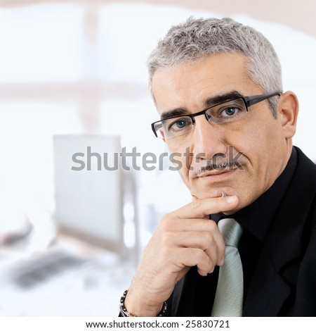 Mature gray haired creative looking businessman thinking. - stock photo