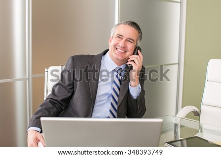 Mature happy business man on the phone - stock photo
