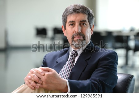 Mature hispanic businessman inside an office  building - stock photo