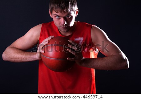 Mature holding his basketball ball - stock photo
