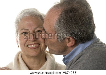 Mature husband still in love kissing his wife - stock photo