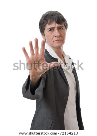 mature lady doing stop gesture with hand isolated on white background - stock photo