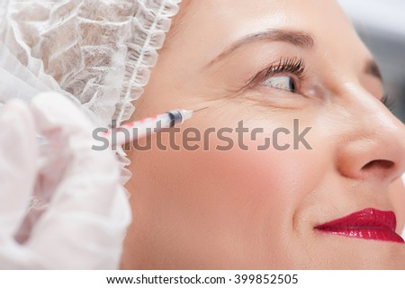 Mature lady gets beauty treatment by cosmetician