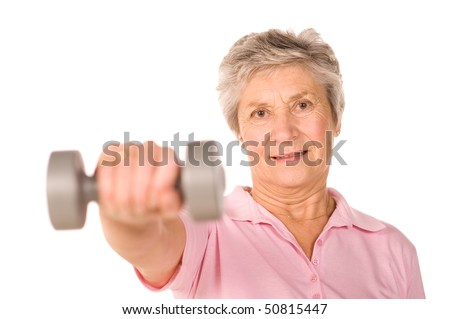 Mature lady lifting weights during gym workout