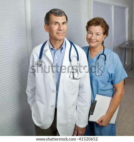 Mature male and female medical professionals