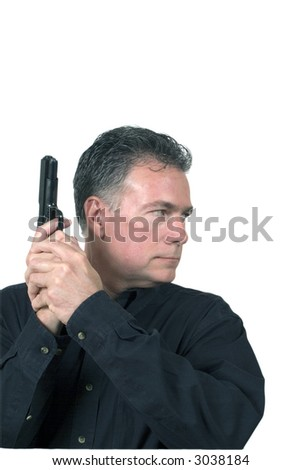 Mature, male poised ready for action with a nine millimeter automatic weapon - stock photo