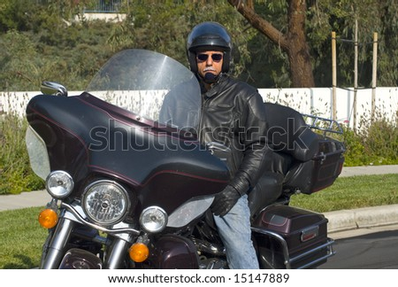 mature male rider on touring motorcycle - stock photo