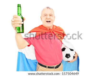 Mature male sport fan with flag of Holland, holding beer bottle and soccer ball, isolated on white background - stock photo