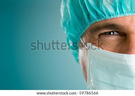 Mature male surgeon gazing and looking at camera at hospital, close up shot - stock photo