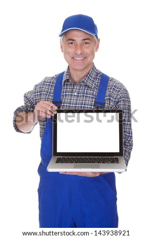Mature Male Technician Showing Laptop Over White Background - stock photo