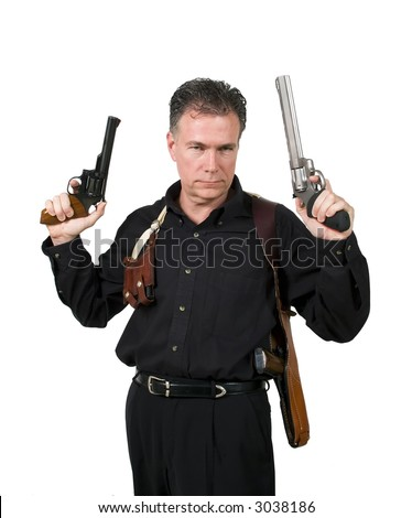 Mature,male wearing a shoulder holster holding a nine millimeter and a 44 magnum. - stock photo