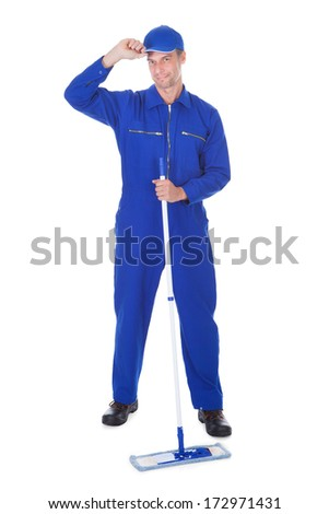 Mature Male Worker In Boilersuit Cleaning Floor Over White Background