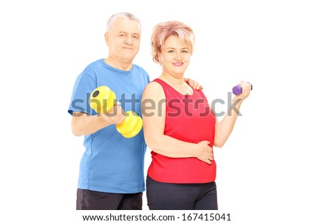 Mature man and woman holding dumbbells and looking at camera isolated on white background