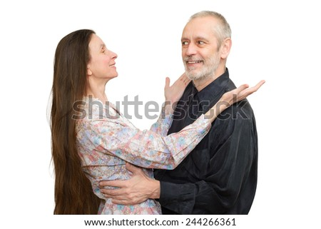 Mature man and woman with long hair looking at each other with love, eyes in eyes, for S. Valentine's day or anniversary. Isolated on white background.