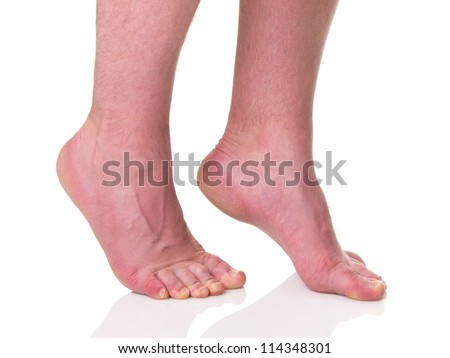 Mature man barefoot with dry skin and nails standing on tips of toes isolated on white background